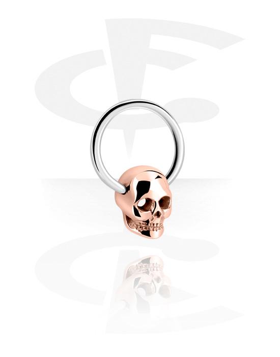Renkaat, Ball closure ring kanssa skull attachment, Kirurginteräs 316L, Ruusukultapinnoitteinen kirurginteräs 316L
